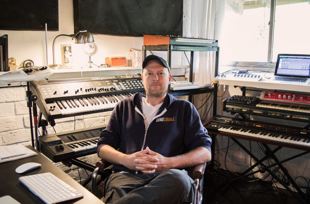 Bandzoogle's Technical Support Manager, Adam, sits in his at-home production studio.